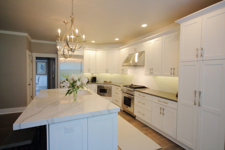 remodeled kitchen with marble countertops