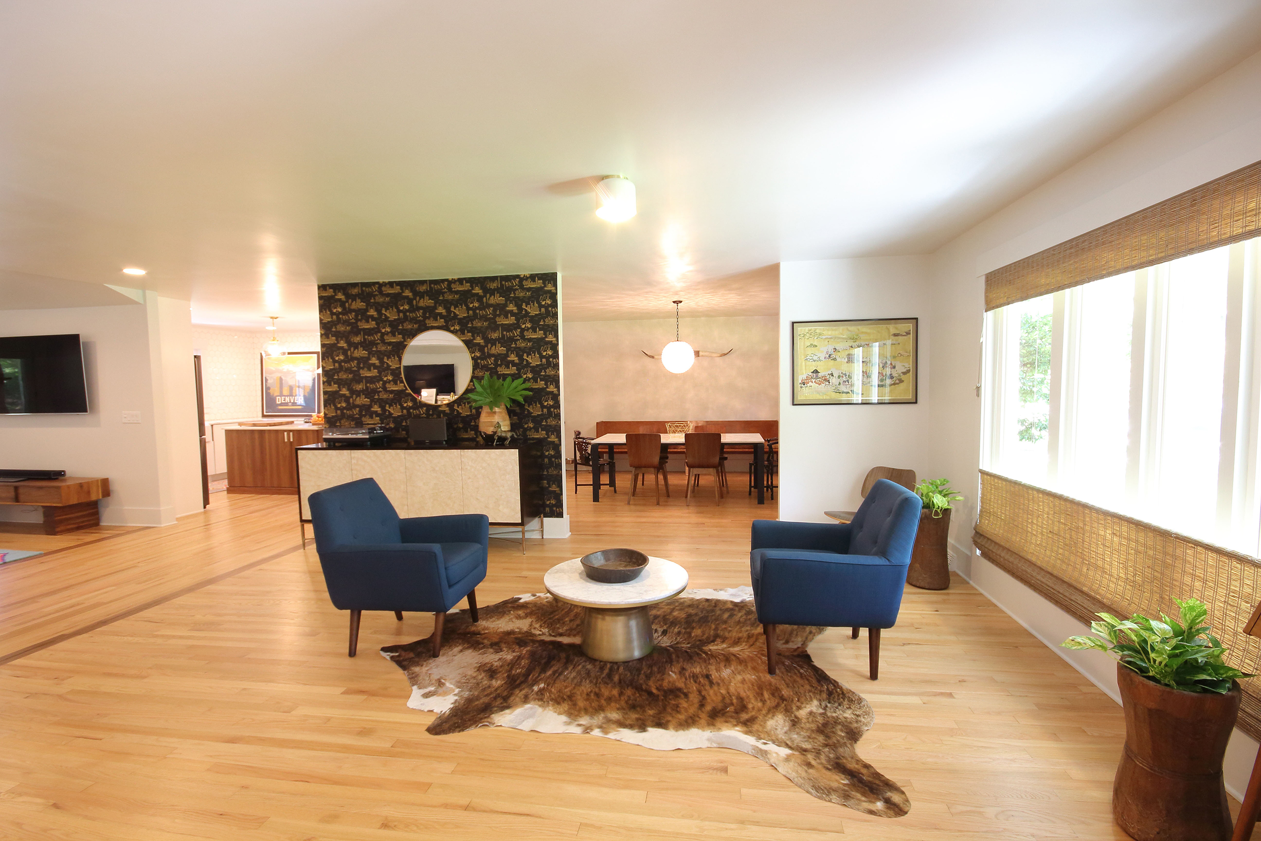 remodeled living space with fur rug