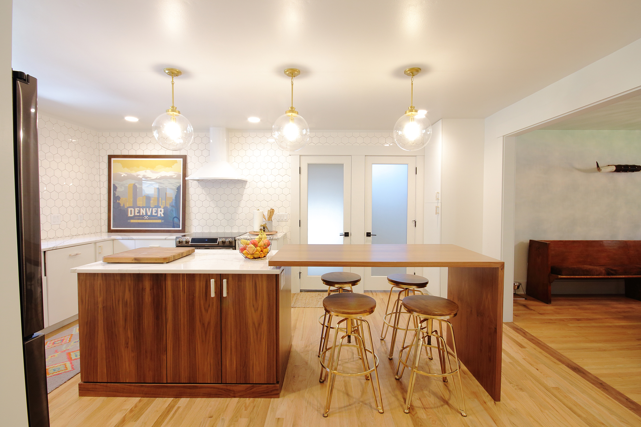 remodeled modern living space with barstools