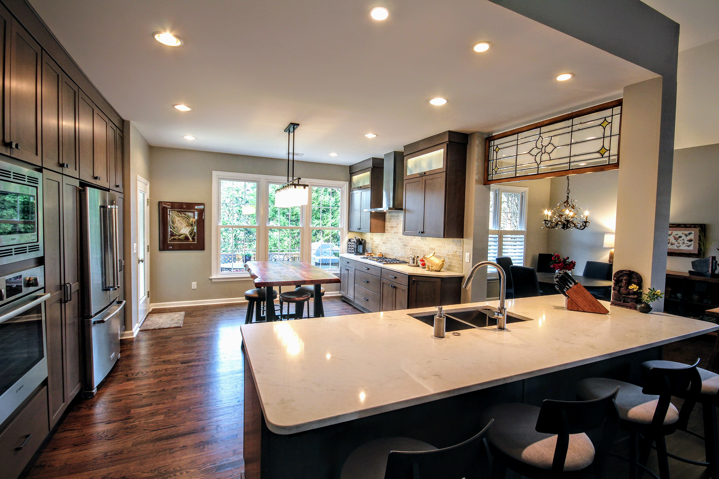 remodeled kitchen project with wood floors and dark cabinets