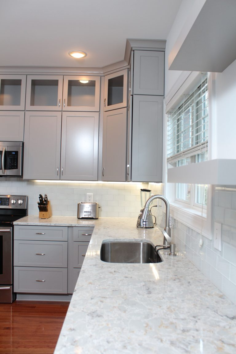 remodeled white kitchen with backsplash