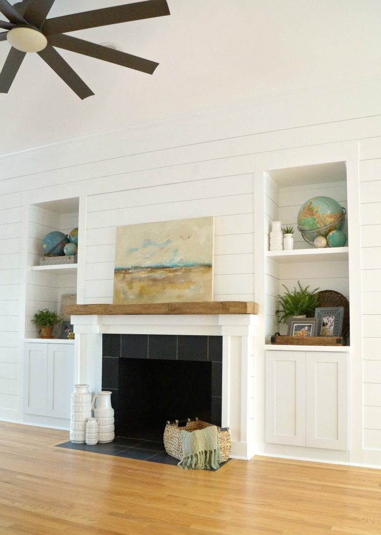 remodeled living space with white fireplace