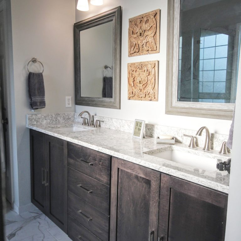remodeled bathroom with granite countertops