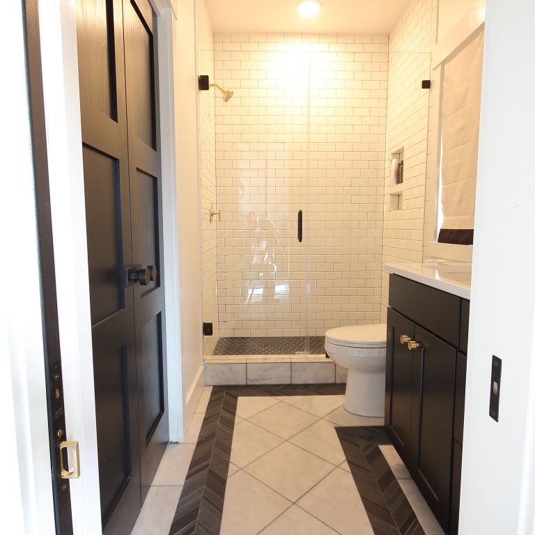 remodeled bathroom with black and white interior